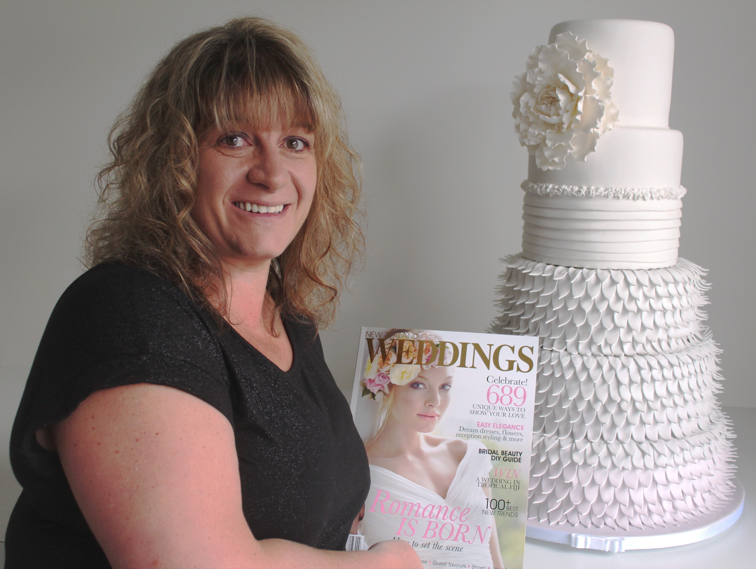 Wedding masterpiece: Alison Lythgow, owner of Cake Alicious in Bell Block, returned from Fashion Week after being named as runner-up for the North Island in the cake decorating section. Photo: Sharyn Smart