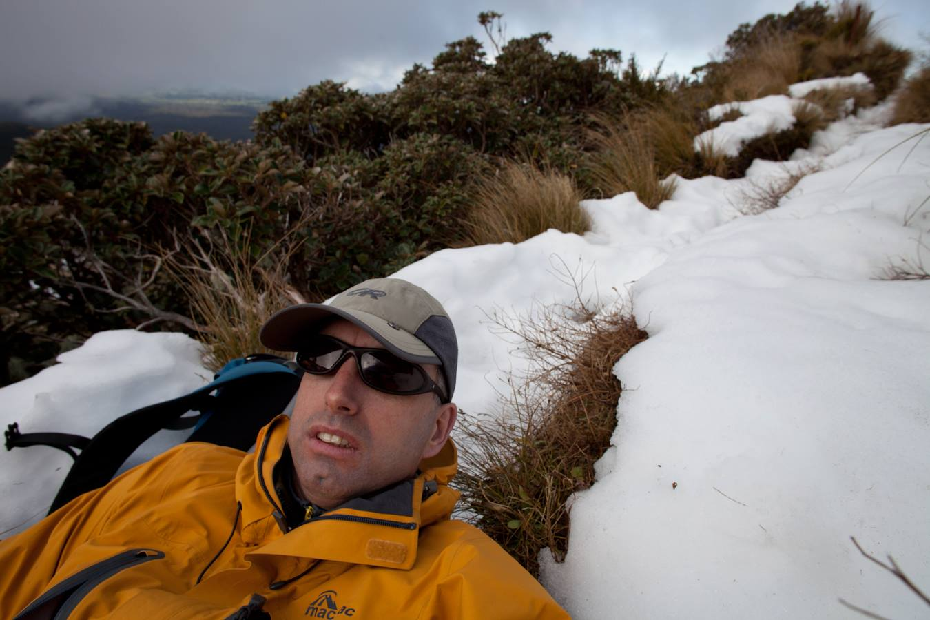 Cold wait: Guy Vickers waits for the Taranaki Rescue Helicopter to rescue him off Mt Taranaki